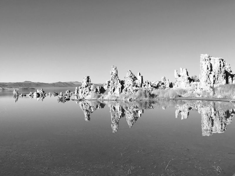 Reflection Water Outdoors Clear Sky Lake Nature Beauty In Nature Day Tranquil Scene Tranquility Waterfront Sky No People Scenics Tree Mono Lake Bnw_friday_eyeemchallenge Bnw_water Mono Lake California Tuff Rock Rocks