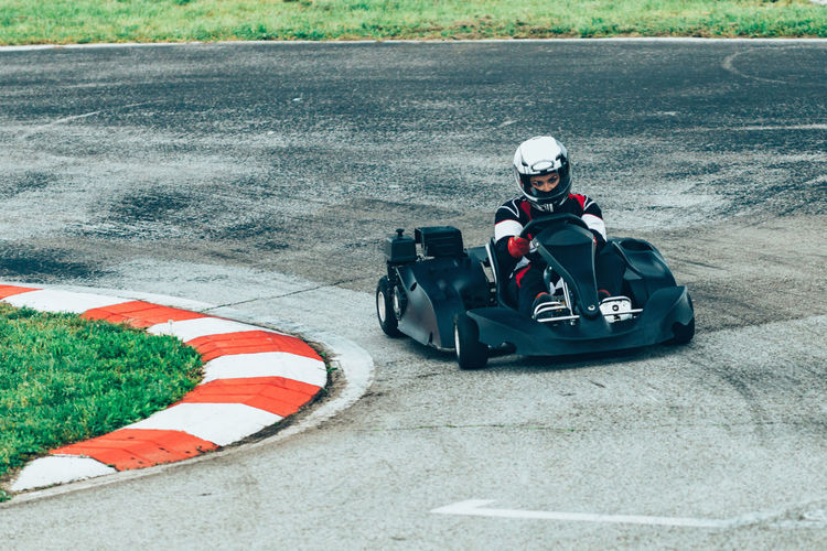 Woman Driving Go-Cart Go-carting Carting Champ Car Racing Soapbox Chart Chart Car Competitive Sport Motorsport Driver Drive Speed Sport Sport Race Motor Racing Track Activity Young Woman Driving Sports Uniform Sports Helmet Lifestyle Car Racing Fun Outdoors Day