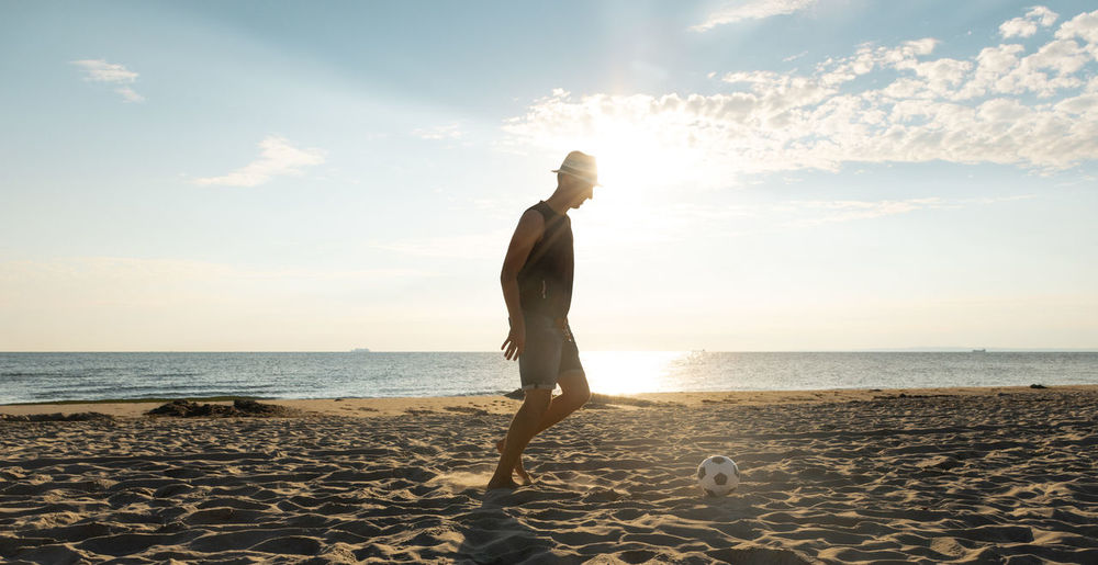 Soccer Ball Sky Water Sea Beach One Person Sunlight Horizon Nature Sand Lifestyles Sport Sunrise Football Coast Sun Baltic Sea Usedom Germany