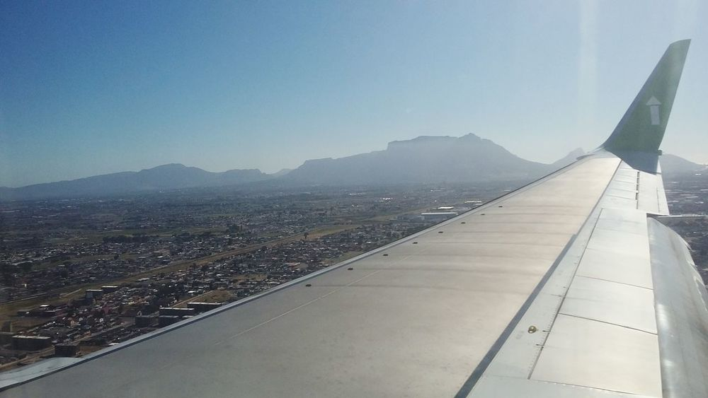 Safe travels ✈ Beautiful Photo of Table Mountain , taken through an airplane-window on my way down. Cape Town, South Africa