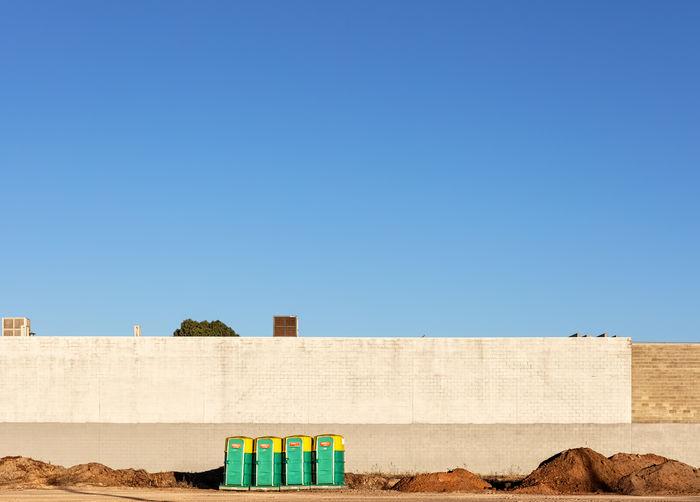 Toilet Bird Blue Building Exterior Clear Sky Day Sky Sunlight Sunny