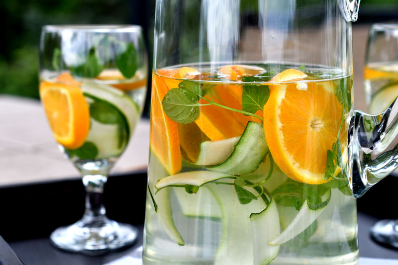 Infused spa water - cucumber slices, oranges and orange mint in water. Cucumber Detox Drink More Water Drinks Hydration InFusion SPA Water Citrus Fruit Cucumber Water Dehydration Detox Water  Drink Drinking Glass Food And Drink Fruit In Water Healthy Healthy Beverage Healthy Eating Healthy Lifestyle Infused Water Refreshing Refreshment Spa Water Water Infusion The Still Life Photographer - 2018 EyeEm Awards