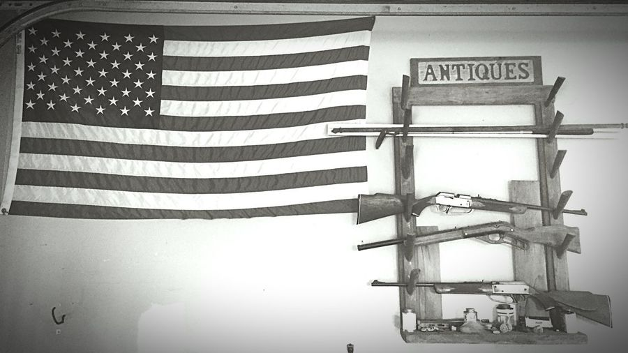 OutLaw Gun Red White And Blue Flag America Constitution Striped No People Built Structure Architecture Day Low Angle View Patriotism Communication Text Sign