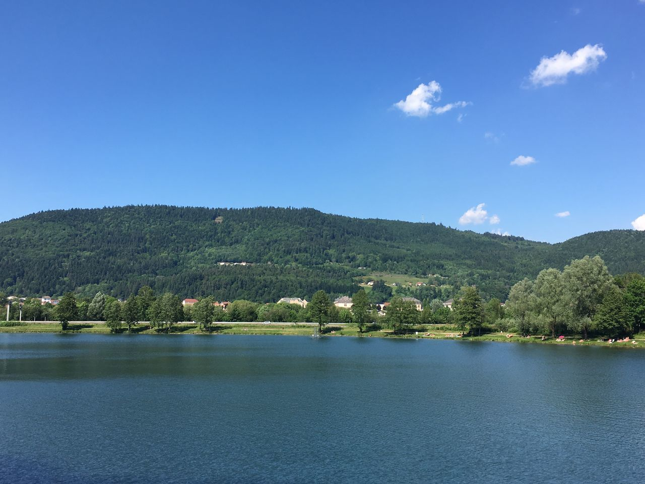 nature, water, blue, no people, tranquility, beauty in nature, waterfront, mountain, lake, scenics, tree, outdoors, sky, day