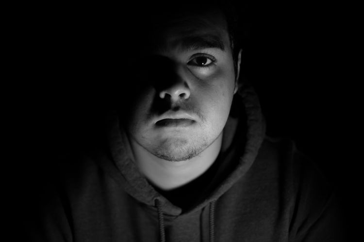 Light and Shadows Black Background Looking At Camera Portrait Headshot Studio Shot Only Men One Person Adults Only Young Adult Close-up One Man Only Watching Adult People Real People Indoors  Film Noir Style Day