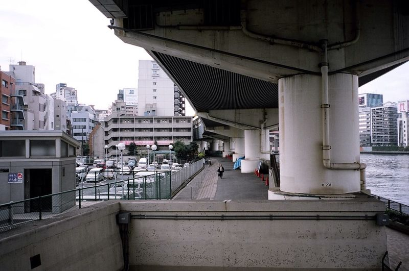 Under Pressure Contax T3 Kodak Portra Film 35mm Film Streetphotography Everyday Lives a running man in the morning in Tokyo