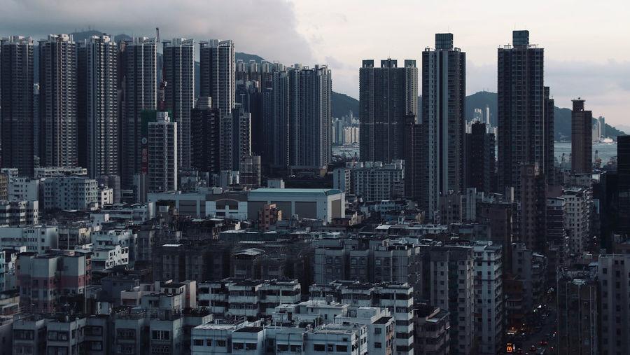 Hong kong modern buildings in city against sky