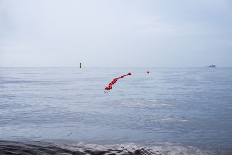 Buoys On Sea Against Sky