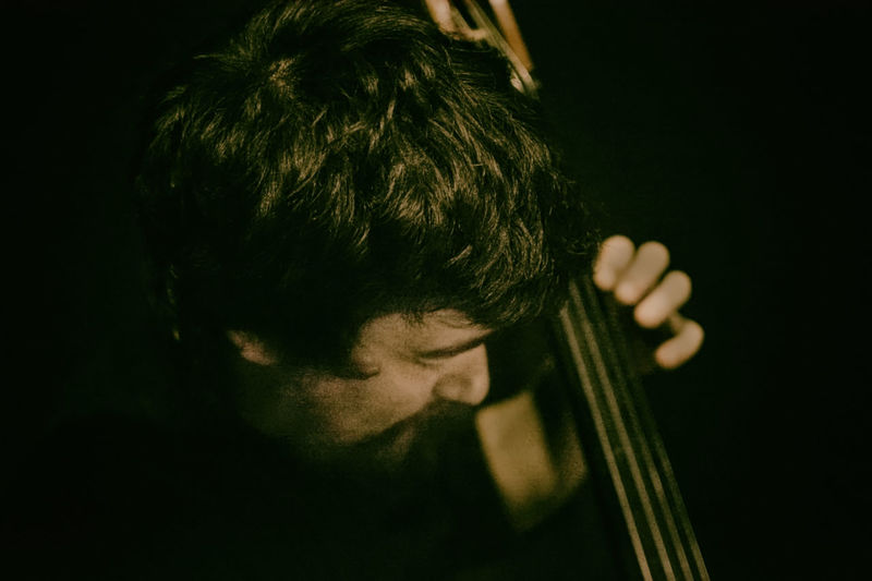 Arts Culture And Entertainment Bass Bass Classic Bass Instrument Bass Player Classical Musician Concert Double Bass Double Bass Player Headshot Music Musical Instrument Musical Instrument String Musician One Person Performance Performing Arts Event Playing Plucking An Instrument Rehearsing String Instrument HUAWEI Photo Award: After Dark