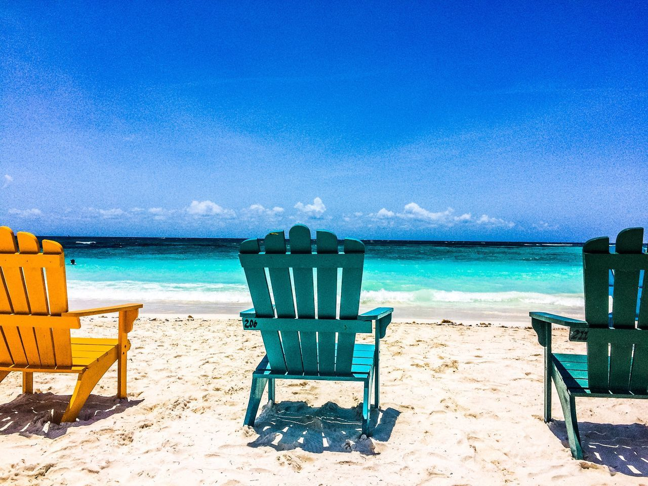 beach, sand, sea, shore, chair, horizon over water, vacations, water, tranquil scene, nature, relaxation, tranquility, blue, summer, sky, beauty in nature, outdoor chair, outdoors, idyllic, scenics, absence, day, sun lounger, sunlight, seat, no people, travel destinations