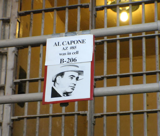 The sign outside the cell that Al Capone occupied - Alcatraz Island, San Francisco Alcatraz Island Al Capone  Architecture Close-up Communication Day No People Outdoors Prison Cell San Francisco Bay Text Tax Evasion Prison Bars Sliding Door