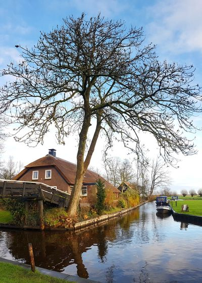 Canals And Waterways Boat Mirror Effect Village Waterways Bridge - Man Made Structure Countryside The Netherlands Bridge Trees House Water Architecture Building Exterior Built Structure No People Outdoors Day Tree Nature