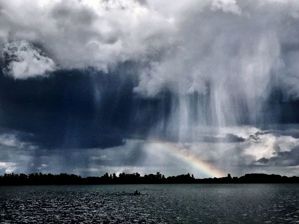 Beauty In Nature Water Cloud - Sky Scenics Nature Sky Outdoors Idyllic Tranquility No People Waterfront Tranquil Scene Day Lake Tree Power In Nature Rainbow Rain Storm Clouds Sea Lakeside Bad Weather Bad Weather On Its Way Gewitterstimmung Lost In The Landscape