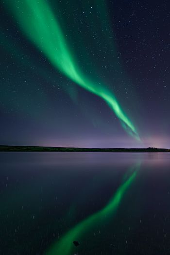 Scenic view of northern lights against sky at night