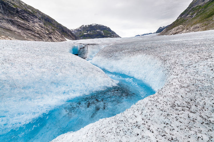 Frozen Global Warming Jostedalsbreen Melting Norway Tunsbergdalsbreen Adventure Beauty In Nature Blue Climate Change Cold Temperature Day Glacial Glacier Ice Iceberg Mountain Nature No People Outdoors River Scenics Sky Snow Water
