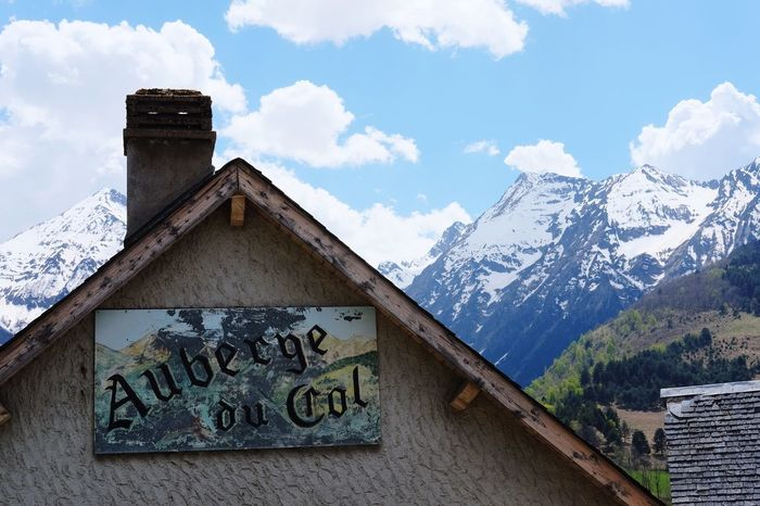Auberge du col Mountain Text Cloud - Sky Sky Snow Day Mountain Range Architecture No People Communication Built Structure Wood - Material Cold Temperature Outdoors Nature Scenics Building Exterior Winter Beauty In Nature Exceptional Photographs Best EyeEm Shot EyeEm Best Shots Eye4photography  Spectacular View