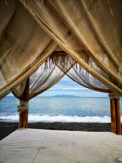 Low angle view of bed over sea against sky