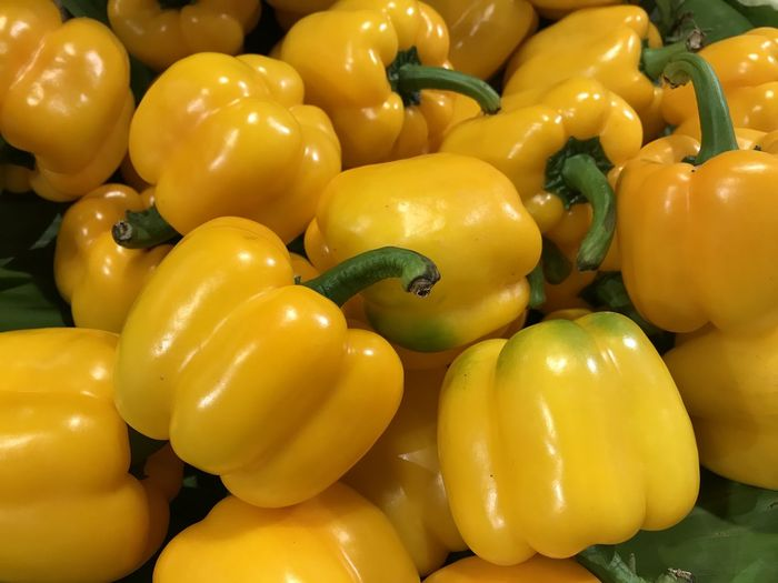 Full frame shot of yellow bell peppers for sale in market