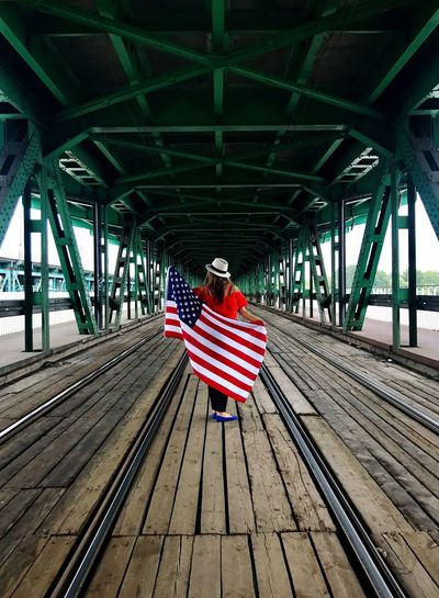 Rear View Lifestyles One Person Real People Bridge - Man Made Structure Women Built Structure Sitting Architecture Day Full Length Outdoors Adult Young Adult People Adults Only Shotoniphone7plus Flag