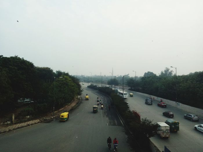 High angle view of vehicles on road against sky