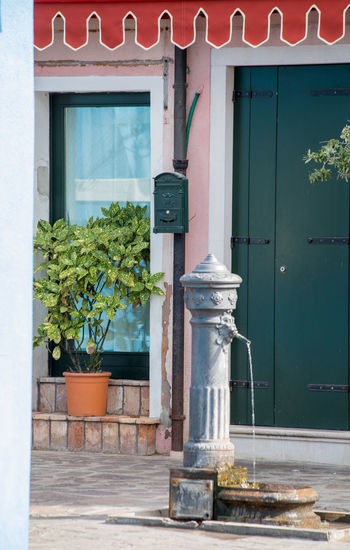 A Day in Burano Building Exterior Door No People Old Fashioned Water Pump Outdoors Plant Travel Destinations Travel Photography Water Fountain Water Source