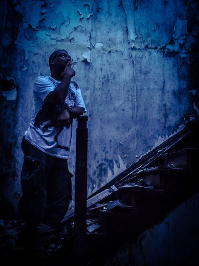 Stairway to heaven. Contemplation Pensive Wall Architecture Broken Stairs Crumbling Full Length Indoors  Life Goes On. Mouldy One Person Peeling Paintwork Real People Smoking - Activity Staircase Sunset EyeEmNewHere