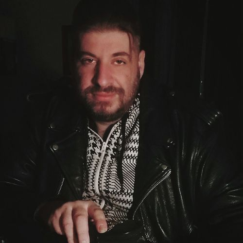 Portrait of man in leather jacket