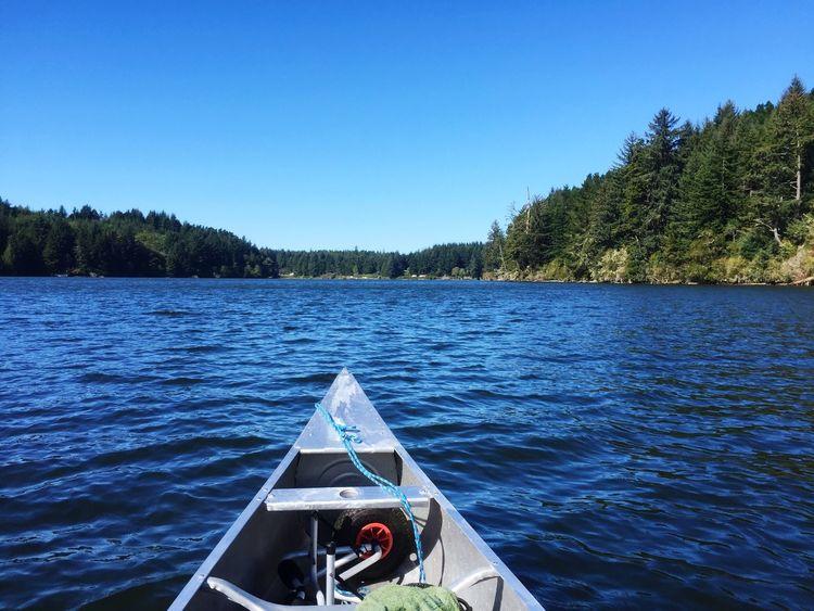 On Tahkenitch Lake Canoeing Enjoying The Sun Fun In The Sun Lakes In Oregon On The Boat
