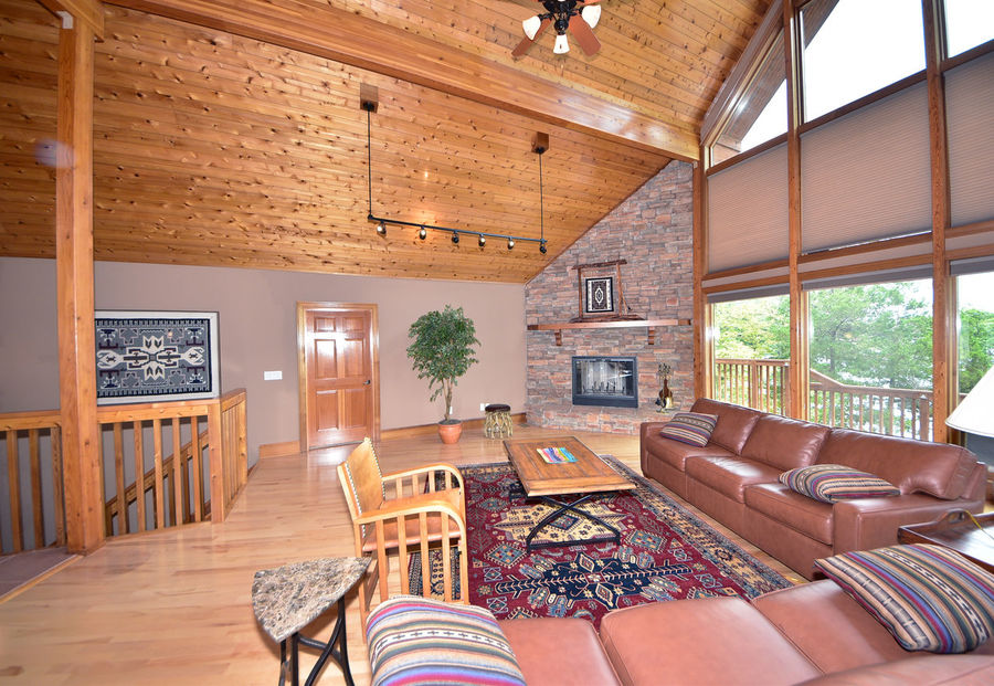 Luxury living in your very own lakeside retreat! Architecture Cathedral Ceiling Domestic Life Fireplace Great Room Hardwood Floor Home Interior Home Showcase Interior Lakeside Living Room Log Cabin Log Cabin Interior Luxury Modern No People Residential Building Residential Structure Rustic Style Southwestern Style