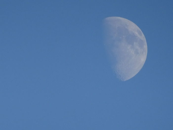 Astronomy Beauty In Nature Blue Blue Sky, Clear Sky, Circle Clear Sky Idyllic Majestic Moon Moon Surface No People Out Outdoors Partial Moon Planetary Moon Scenics Sky Tranquil Scene Tranquility