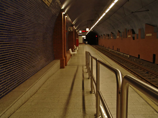 Absence Architectural Column Architecture Built Structure Ceiling Diminishing Perspective Direction Empty Illuminated In A Row Indoors  Lighting Equipment Night No People Public Transportation Railing Subway Station The Way Forward Transportation