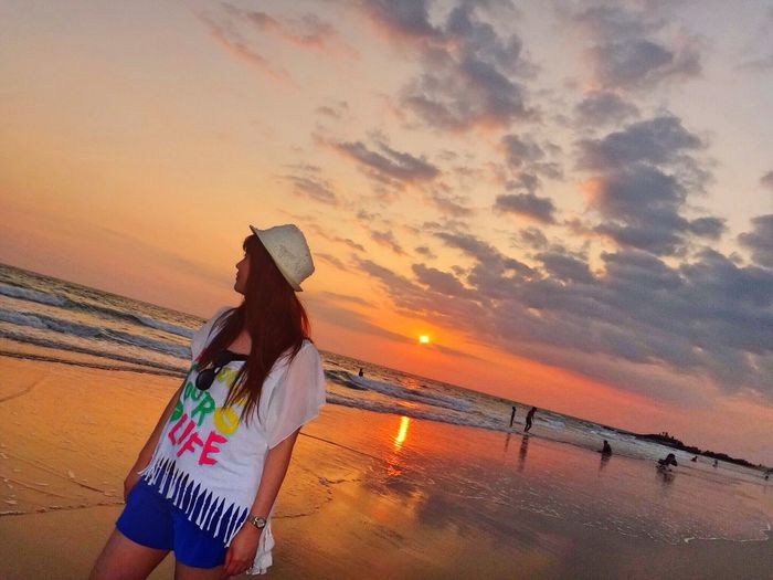 Sunset Sky Beach Water Sea Land Women Beauty In Nature Real People Adult Nature Lifestyles Standing Outdoors