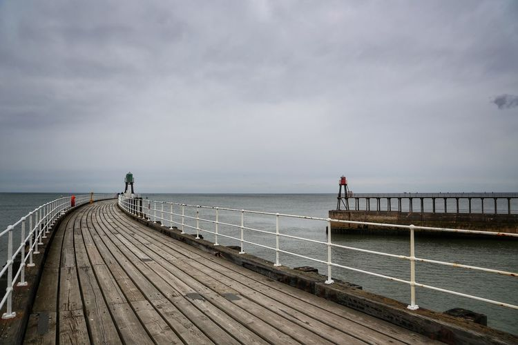 Whitby Whitby Whitby Abbey Sky Water Railing Cloud - Sky Sea Pier Nature Beauty In Nature Wood - Material Built Structure Scenics - Nature Horizon Architecture Horizon Over Water Tranquility Real People Incidental People Outdoors Wood Paneling