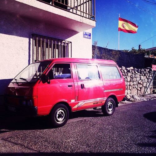 Untold Stories Nissan Vanette Red Coach SPAIN Red Car Flag On The Way Colour Of Life