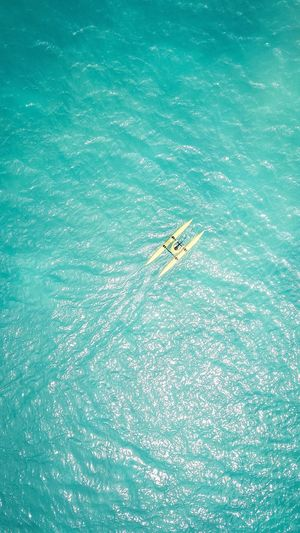 Aerial View Of Man In Boat At Sea
