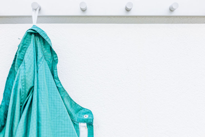 Close-up of shirt hanging against wall