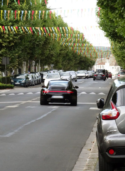 SUMMER French road National In The City Colored Little Flags City Outdoors Cars On Road Street Road City on the move Black Porsche Road Scape Porsche In The Middle