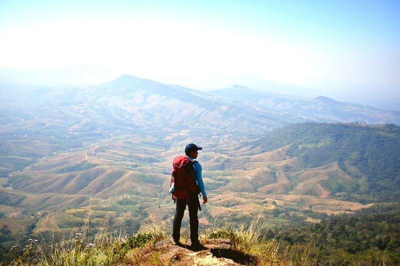 Rear View Of Backpacker Looking At Mountains