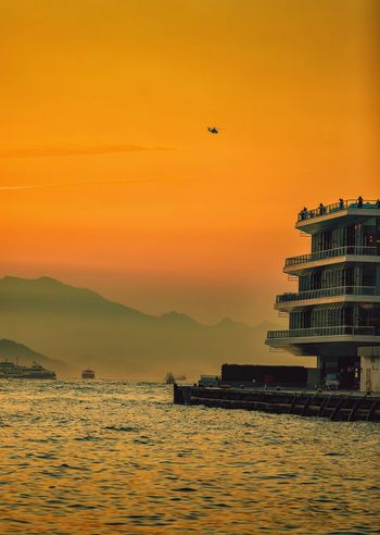 Victoria Harbor Sunset Glow Victoria Harbor Hong Kong Sunset Outdoors Nature No People Scenics Architecture Built Structure Sky