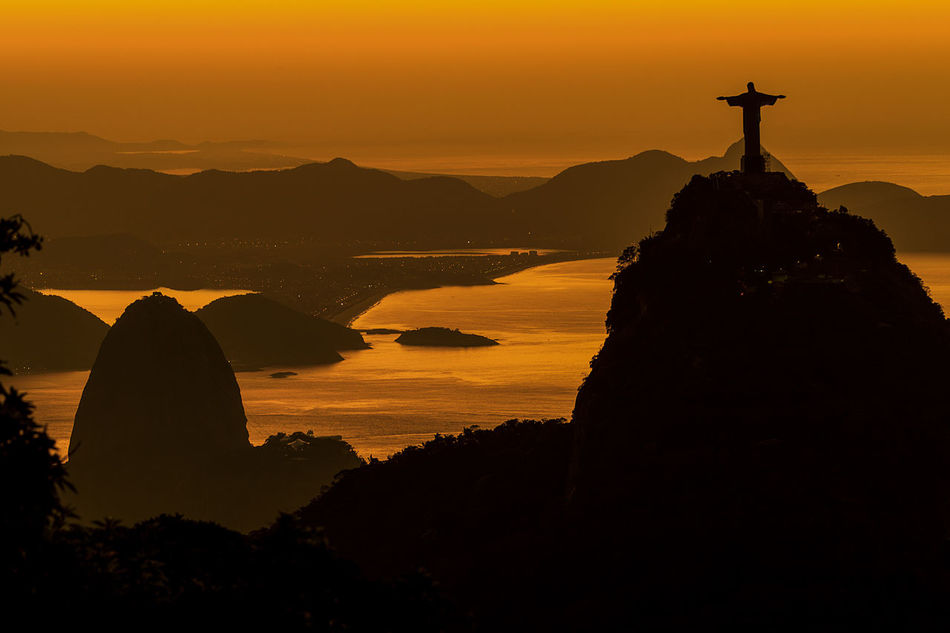 Sunrise on the Rio de Janeiro Christ The Redeemer Cristo Redentor-Río De Janeiro Orange Sky Rio De Janeiro Brasil Photos Official EyeEm © Sunrise_Collection Architecture Beauty In Nature Built Structure Day Landscape Mountain Nature No People Outdoors Religion Scenics Sea And Sky Silhouette Sky Spirituality Statue Sunset Tranquil Scene Tranquility Travel Destinations