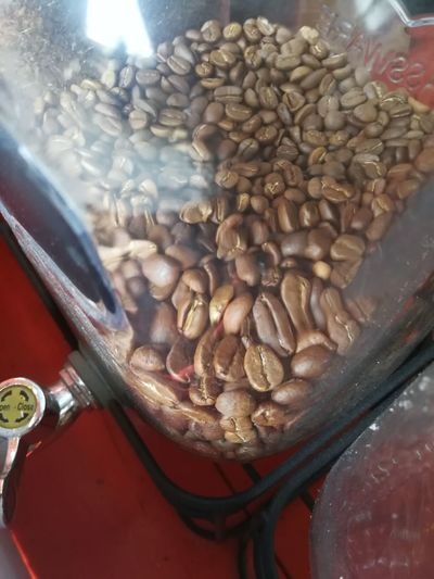 High angle view of coffee beans in glass