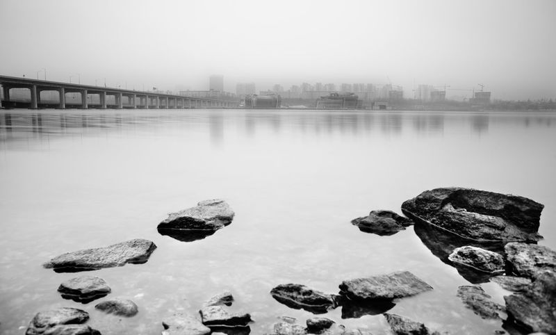 Asia,South Korea,Seoul Han RIver Banpo Bridge Calm Cold Cold Temperature Han River Lake Lakeshore Outdoors Reflection Rippled River Riverbank Scenics Seoul Seouth Korea Standing Water Tranquil Scene Tranquility Tree Water Waterfront Weather Winter Landscapes With WhiteWall