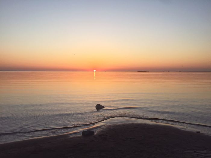 Sea Water Sky Scenics - Nature Sunset Beauty In Nature Horizon Horizon Over Water No People Orange Color Non-urban Scene Land Idyllic Clear Sky Outdoors Tranquil Scene Beach Nature Copy Space Tranquility