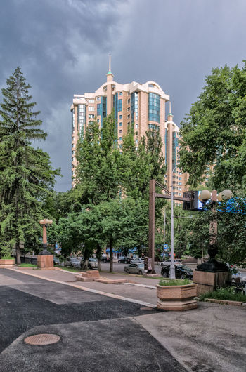 Almaty Almaty City Almaty, Kazakhstan AlmatyMyFirstLove Architecture Building Building Exterior Built Structure City Clouds Clouds And Sky Day Growth Kazakhstan Nature No People Outdoors Sky Street Street Photography Streetphotography Tree Tree Trees Weather