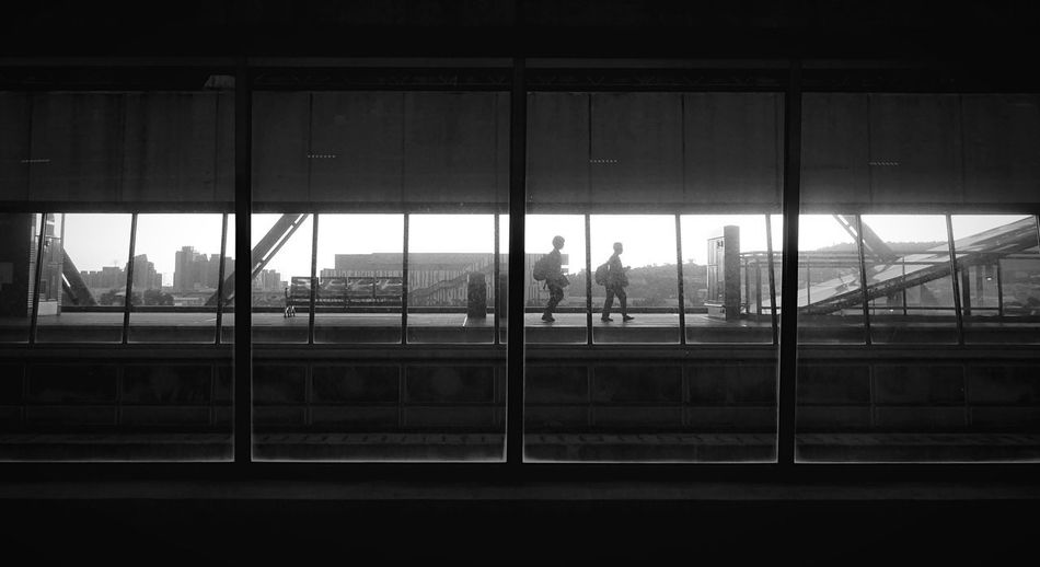 Silhouette people in airport building