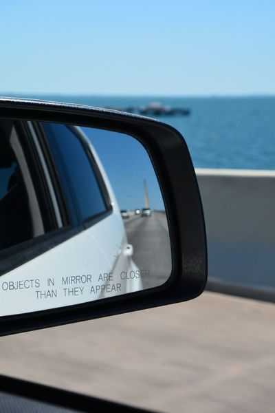 objects in mirror are closer than they appear View from the passenger side riding over the Sunshine Skyway Bridge (I-275) Tampa Bay area Flo Objects In Mirror Are Closer Than They Appear Sunshine Skyway Bridge Horizon Over Water Scenics Outdoors Clear Sky Bridge - Man Made Structure Passenger View Passenger Side View Over The Bridge Tampa Bay Side View Mirror Side-view Mirror Highway Vehicle Mirror Driving Roadtrip Journey Transportation Water Mode Of Transport