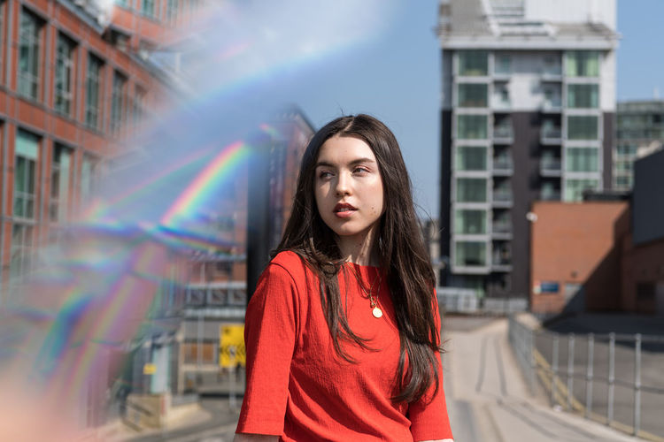 Reflection The Fashion Photographer - 2018 EyeEm Awards Architecture Beautiful Woman Brown Hair Building Exterior Built Structure Casual Clothing Leisure Activity Long Hair One Person Outdoors Portrait Prism Rainbow Standing Teenager Young Adult Young Women