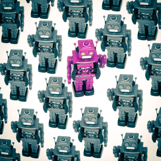 not following the crowed Care Free Living ❤ Happy Not Following The Crowd Standing Out From The Crowd Change Direction Conceptual Crowd Directly Above High Angle View Independance Indoors  Induvidual Large Group Of Objects No People Origanal Pink Color Robots , Still Life Studio Shot Switched On Technology Toy Toyphotography Woke Up