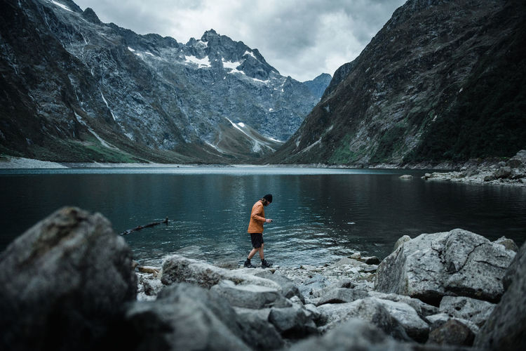 Lake Marian - New Zealand Mountain Water One Person Lake Beauty In Nature Scenics - Nature Leisure Activity Lifestyles Mountain Range Outdoors Day New Zealand Adventure Hiking