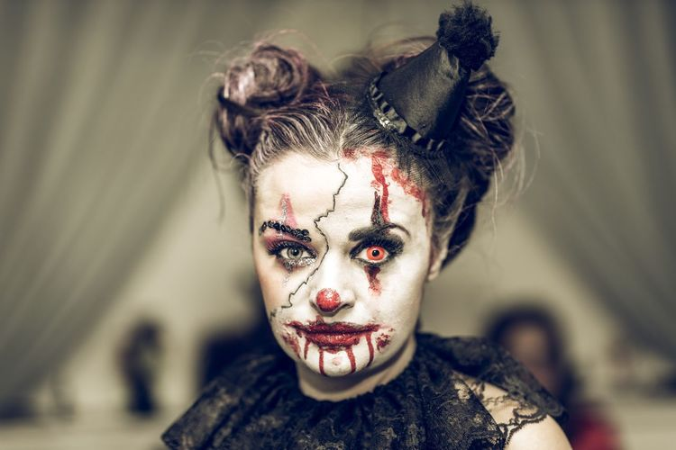 Close-up portrait of young woman with spooky halloween make-up